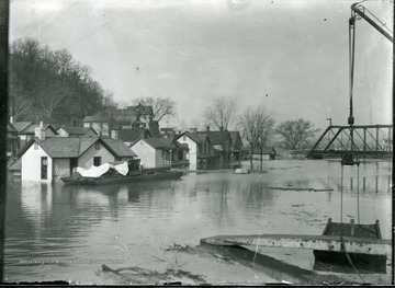 Flooded houses by a bridge, Parkersburg, W. Va.