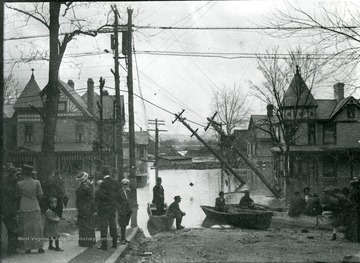 Flooded street. Rescue boats and people gathered by flooding waters near downed power lines, Parkersburg, W. Va.