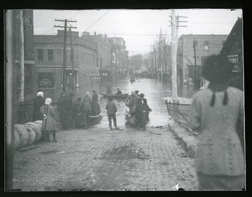 Townspeople are pushing their boats down an unidentified street in Parkersburg, West Virginia during the flood of 1913.