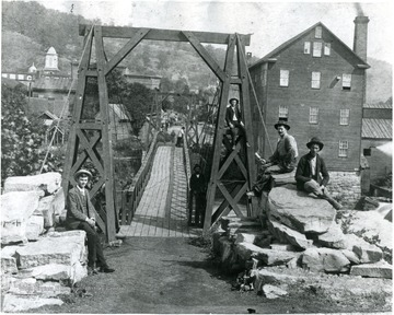 'Footbridge across the West Fork of the Monongahela River, Weston, W. Va., directly in front of the main entrance to the Weston State Hospital, ca. 1895.'