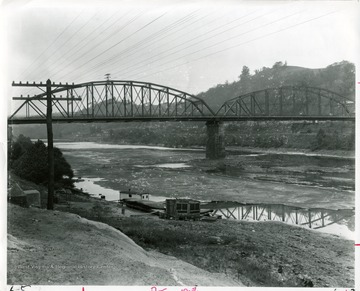 'Many Morgantown residents can remember walking across the dry river bed during the 1930 drought.'  Morgantown and Westover bridge visible.