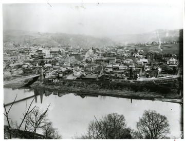A portion of a panoramic view of Morgantown, West Virginia and the Morgantown/Westover Suspension Bridge.  For other portion of photograph see image 008062.