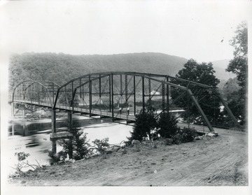Two men walking on the new bridge over Cheat River at Ice's Ferry near Morgantown, W. Va.