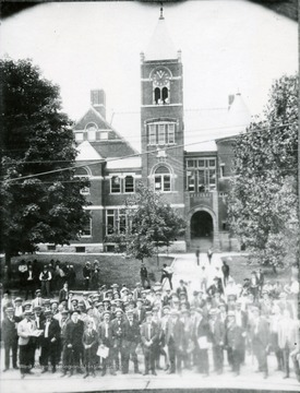Crowd can be seen in front of the courthouse in Morgantown, W. Va.