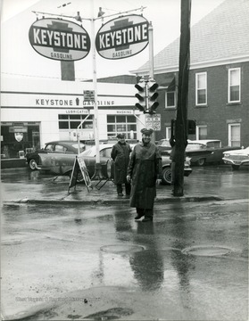 Two police officers standing on the corner of Spruce and Pleasants Streets (Lt. Oscar Clingan front, Ch. John Lewis back.)  Morgantown, W. Va.