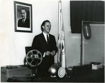 C.W. Halstead, C and P Telephone Company, Charleston, W. Va., demonstrates sound transmission on a laser beam at Morgantown Research Center, U.S. Bureau of Mines, Morgantown, W. Va.