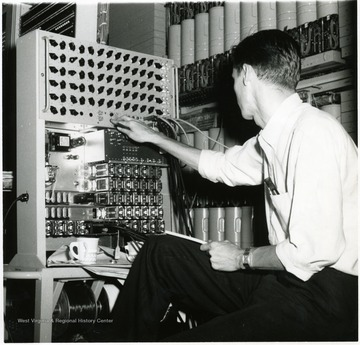 Man working on the C and P telephone centrex installation on Collins Ferry Road, Morgantown, W. Va.
