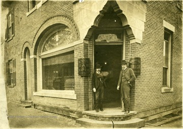 Men standing in front of Company building in Morgantown, W. Va.