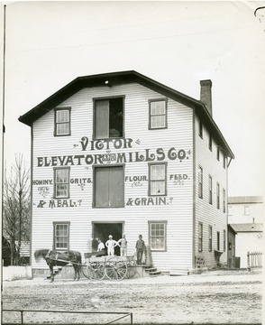 'Victor Elevator and Mills Co. North of Walnut St. on the West side of University Ave.  Built by the late E. C. Allander about 1885.'