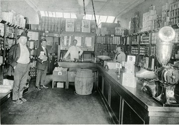 Old A&P Food Store, Morgantown, W. Va., located on Walnut Street. Employees standing behind the counter, a few shoppers in store.