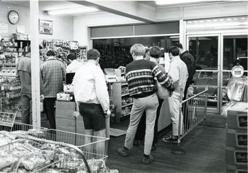 Sunnyside Superette convenience store located on University Avenue in Morgantown, W. Va. Shoppers waiting to check out with products.