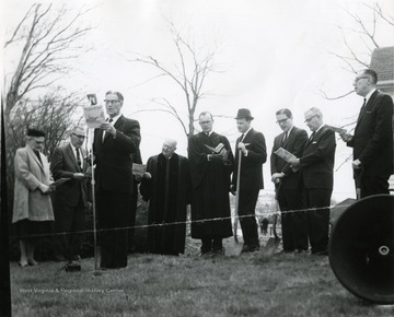 Ground breaking at the site of the Drummond Chapel. Located in Morgantown, W. Va. Some people attending are 'Reverend Charles High; L. Bush Swisher; Glen Liston, Bob Bennett; Chester Arents, Dean, College of Engineering.'