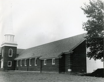 Exterior view of Drummond Chapel, located in Morgantown, W. Va. Steeple seen topped with a cross.