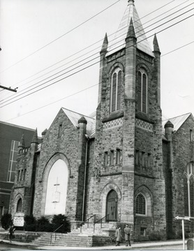 Wesley Methodist Church located on Willey Street near the campus of West Virginia University in Morgantown, W. Va.  People seen near the Church.