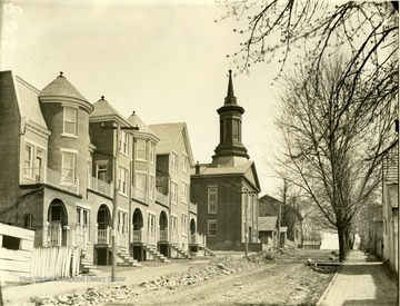 'Old Methodist Church on Brick Row. Commencement used to be held there. Dr. Martin, First President of the University (WVU), was presented with keys by the late Judge J. T. Hoke, who was a member of Board of Regents. 1867' 'Rufus A. West.'