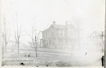 'The Fam Evan's house on the South side of Willey east of Spruce.  Showing the Phi Kappa Psi house.  Now the Cap Hatfield property.'