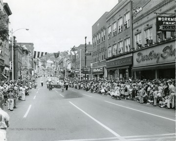 Crowds line the street to watch the Labor Day Parade.