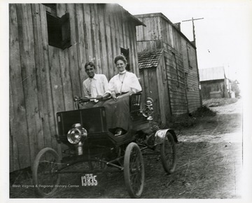 Harry Selby and an unidentified woman are riding in car in Morgantown, West Virginia.