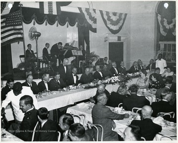 'View of the speakers table at banquet held at Hotel Morgan, Morgantown, W. Va. on the evening of Nov. 17, 1941 at the conclusion of defense day celebration, which marked the start of production at Morgantown Ordnance Works.  $38,000,000 anhydrous ammonia plant erected for the War Department by E. E. du Pont de Nemours  and Co. under supervision of the construction division, Quartermaster Corps.'