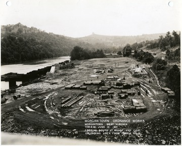 '11:00 A.M. June 14, 1941.  Looking south at wharf and coal unloading area from tower No. 3. Photograph Number 138.'
