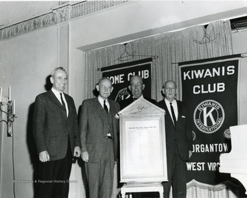 Members of the Kiwanis Club. Some of the members in this photo include: 'Eugene Detrick and Mr. Ryder'.
