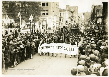 Members of University High School march down the street during the Sesquicentennial Parade in Morgantown, W. Va.