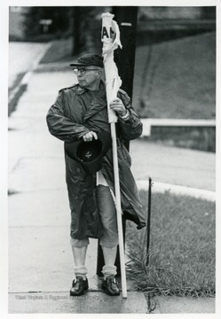 Man holding a flag.
