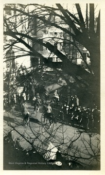 Armistice parade, High Street and Willey Street in Morgantown, West Virginia. 'Jacques in center.'