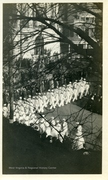 Sailors march around the corner at Willey and High Streets.