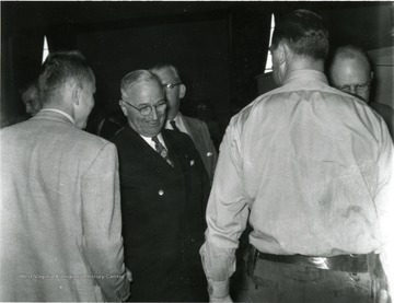 President Truman being greeted by people.