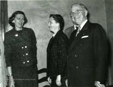 President Truman seen with 'Ann Hearst' and 'Valena Powell'.