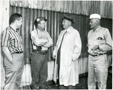 'Picture taken at the Humphrey Preparation Plant. Left to right: Bill Poundstone-Superintendent of Humphrey Mine, Elber Yocum-Member of Mine Committe (United Mine Workers of America - 1058), George Humphrey, Ray Hayhurst-Lampman at Humphrey Mine Portal and first President of Humphrey local Union.'