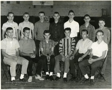 A group portrait of the Riverside Junior High School Mixed Chorus. Seated left to right are:  Eddie Taylor, John Hayes, Dave Allen, Eddie Cummings, Richard Robinson, and Joe Adams. Standing left to right are: Larry O'Conner, Buddy Mackley, Roger Hoover, Robert Hayhurst, Dave Kisner, Frank DeMasi, and David Erenrich.