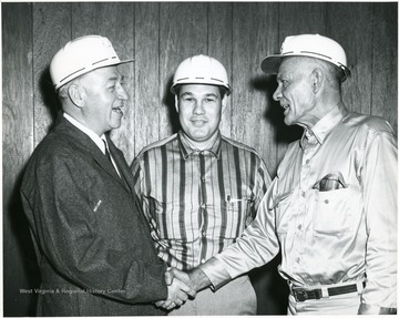 From left to right: 'Geo Humphrey, Bill Poundstone-Superintendent of Humphrey Mine, Ray Hayhurst- President of Humphrey mine local Union (United Mine Workers of A-1058) at time mine was first opened. Presently lampman at mine portal where picture was taken.'