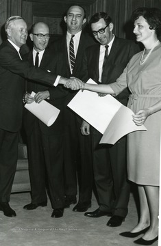 'Governor Smith' located on far left, third from left is 'Julius Singleton'.