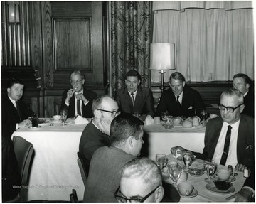 Seated at the back table, from left to right:  John Patrick Ball, Judge Don J. Eddy, Dean Paul L. Selby, Edgar F. Haskell III and Robert W. Dinsmore.  At the front table on the far right is Oakley J. Hopkins, and facing directly in front of him is Charles Haden II.