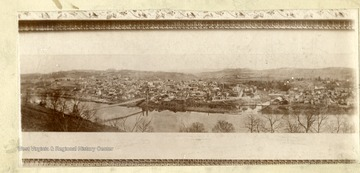 'View of Morgantown from Keck's Hill across the River. Note the Suspension Bridge as well as the old covered Durbana Bridge across the Deckers Creek. Taken in late  eighties. Property of Jas. R. Moreland.'