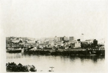 'Looking east from West Side of Monongahela River (Coal Tipple) showing Baltimore and Ohio Depot and Hotel Morgan.'