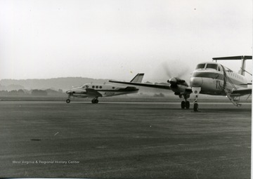 View of a a Beechcraft 1900C and a Beechcraft King Air a (smaller air craft) on Hart Field Morgantown W. Va.<br /><br />