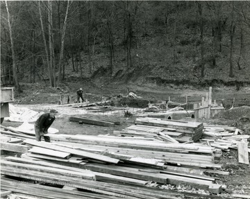Men working on a subterranean bridge over Decker's Creek at Marilla.