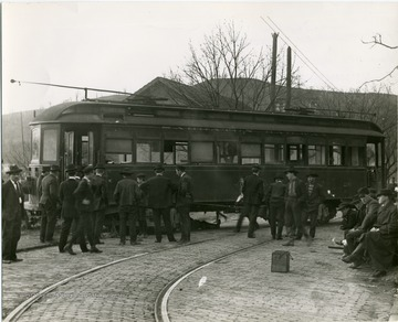 Men stand near a Sabraton Railway car.
