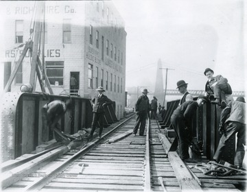 Men working on the railroad trestle at the foot of Walnut Street.