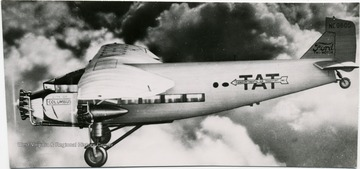 "Writing on the aircraft includes, "" TAT, Transcontinental Air Transport Inc.,"" ""City of Columbus"" and ""Ford Tri-Motor""."