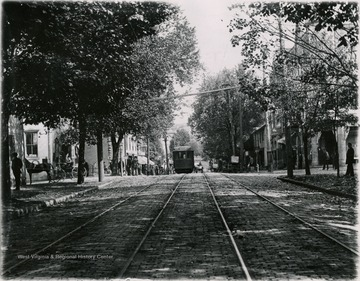 Street car on corner of High Street and Pleasant Street. Moore and Parriott's drug store on the right side corner.