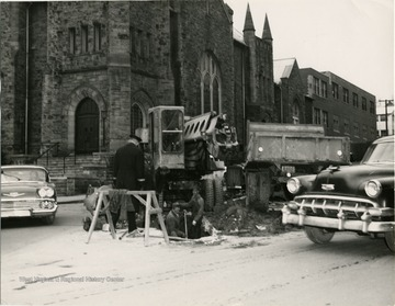 Repairing Willey Street in front of Wesley Methodist Church.