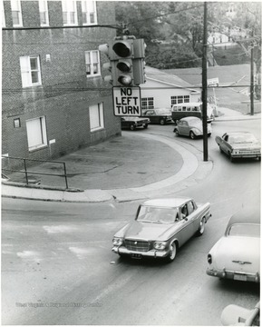 Cars on University Avenue near the old Mountaineer Field.