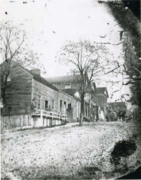 Unpaved Pleasant Street, possibly 1860s.