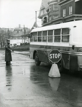 Oscar Clingan is standing in the rain near a Osgood Bus on Spruce Street in Morgantown, West Virginia.
