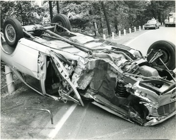 A car accident where the car was totaled and flipped upside down.