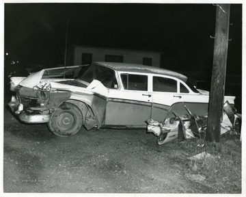 View of wrecked car at night in Morgantown, W. Va.